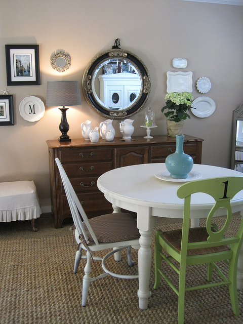 lime green dining chair and gallery wall