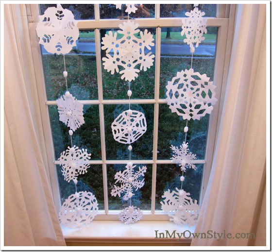 Paper Snow Flake Garland and How to Cut Out Paper Snowflakes