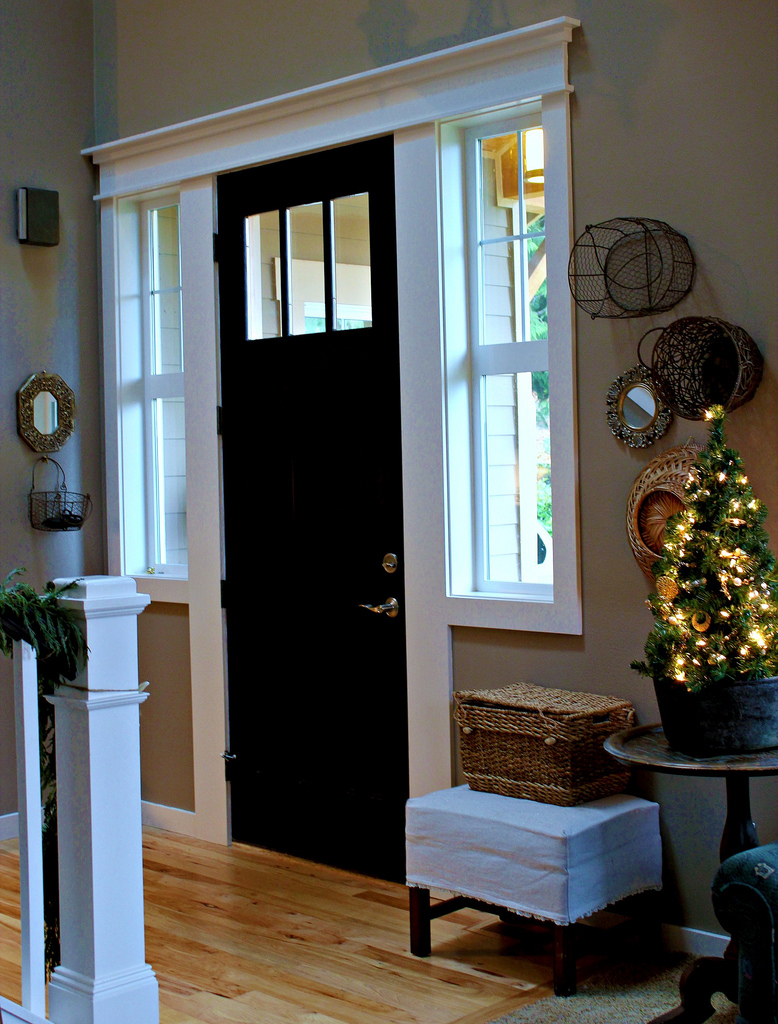 black front door, decorating with baskets