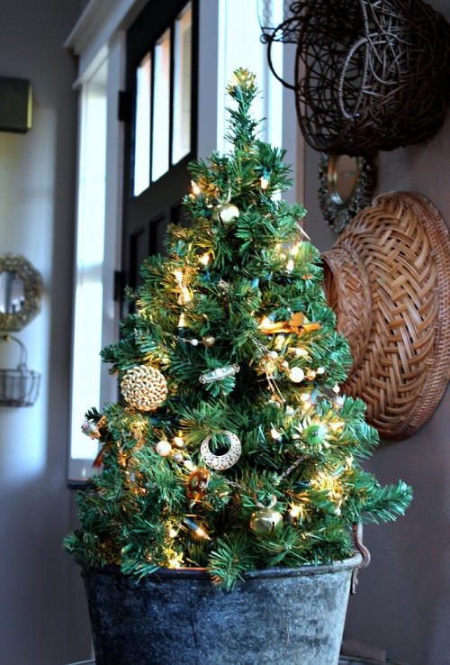this tree is uniquely decorated with the gold jewels and jingle bells for a vintage appeal the most innovative feature is the iron pot though - Small Decorated Christmas Trees
