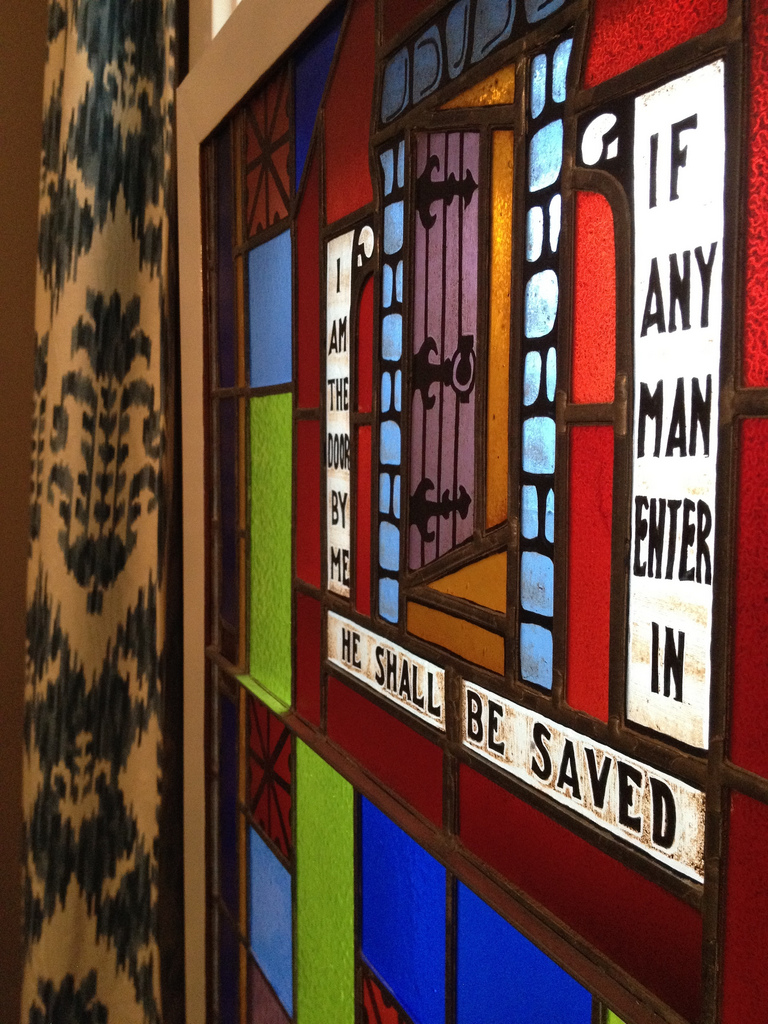 church stained glass window i am the door if any man enter in he shall be saved
