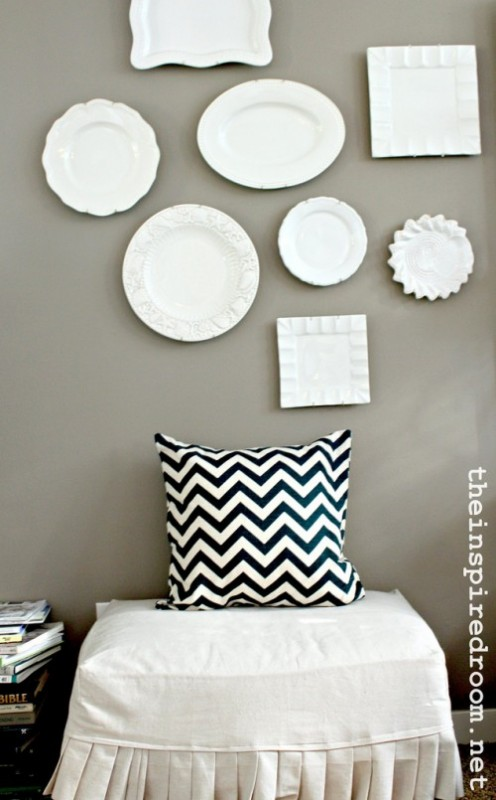 chevron pillow white plates hung on wall