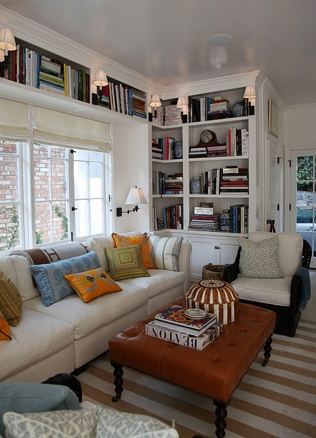 white walls bookcases around window