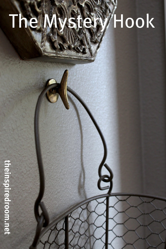 The mystery hook wire basket hanging from a hook the for Hang photos from wire