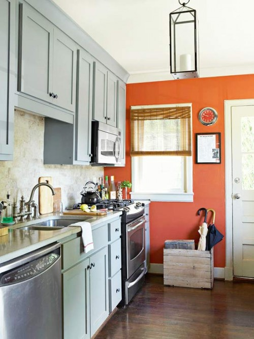 colored cabinets kitchen and orange accent wall