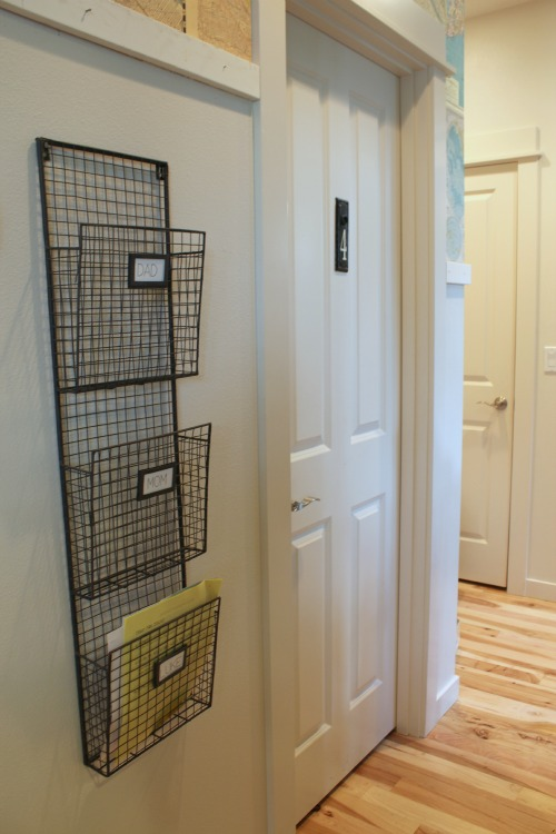 organizing with a wire basket in hall