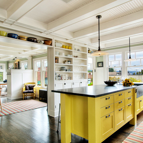 White, bright kitchen with yellow island