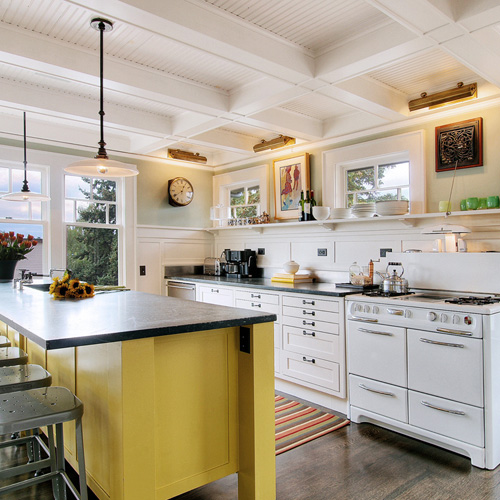 White, bright kitchen with yellow island via The Inspired Room