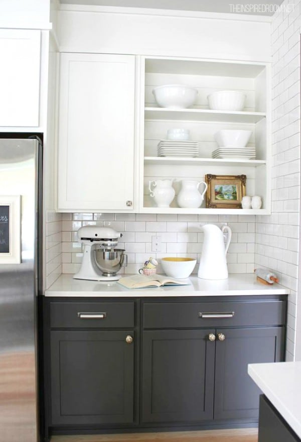 Kitchen baking area with open cabinets and two tone gray and white cabinets
