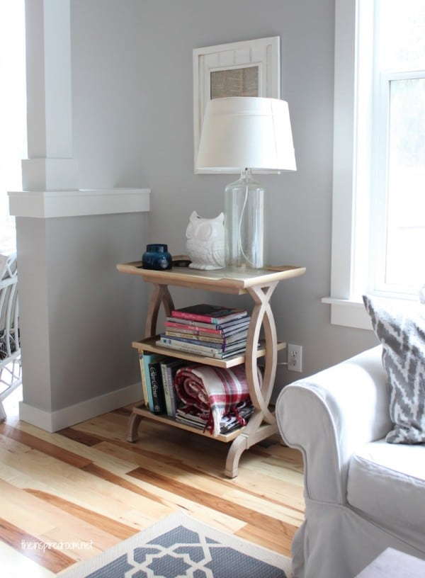 end table bookcase and glass bottle lamp