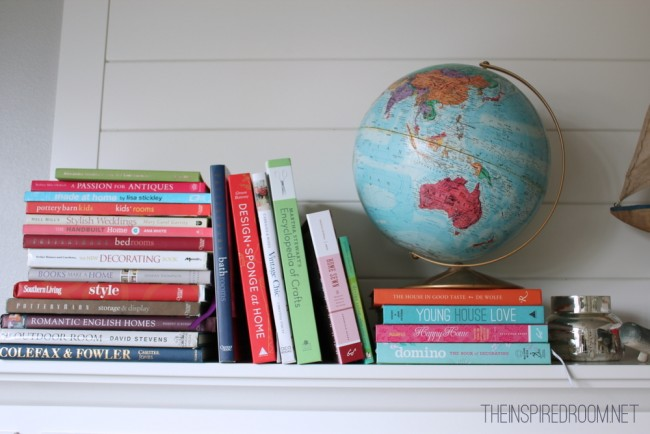 books and globe on mantel
