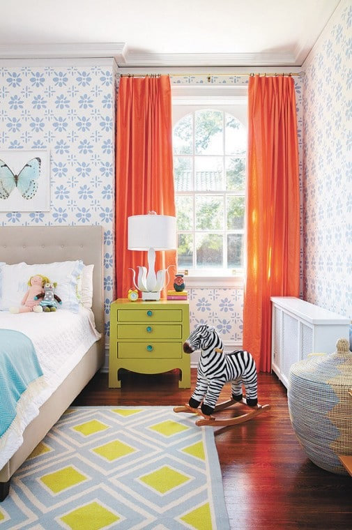 Colorful children's bedroom with orange curtains