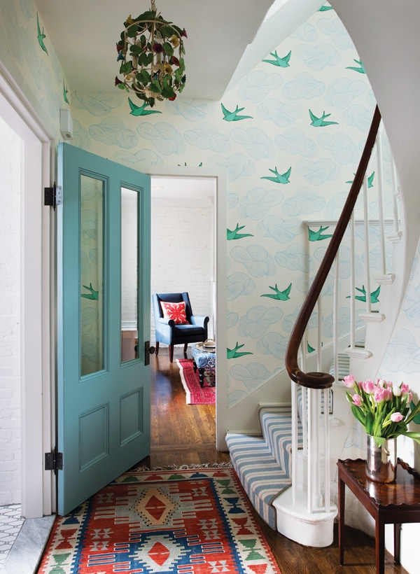 Colorful entry with bird wallpaper