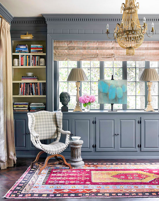 grey built ins and colorful rug