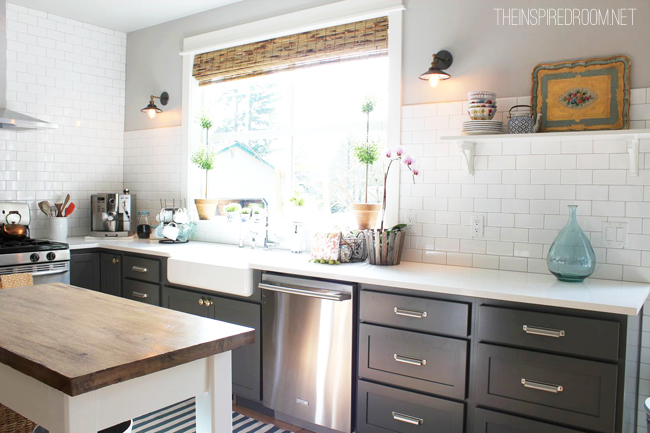 kitchen with grey cabinets and subway tile