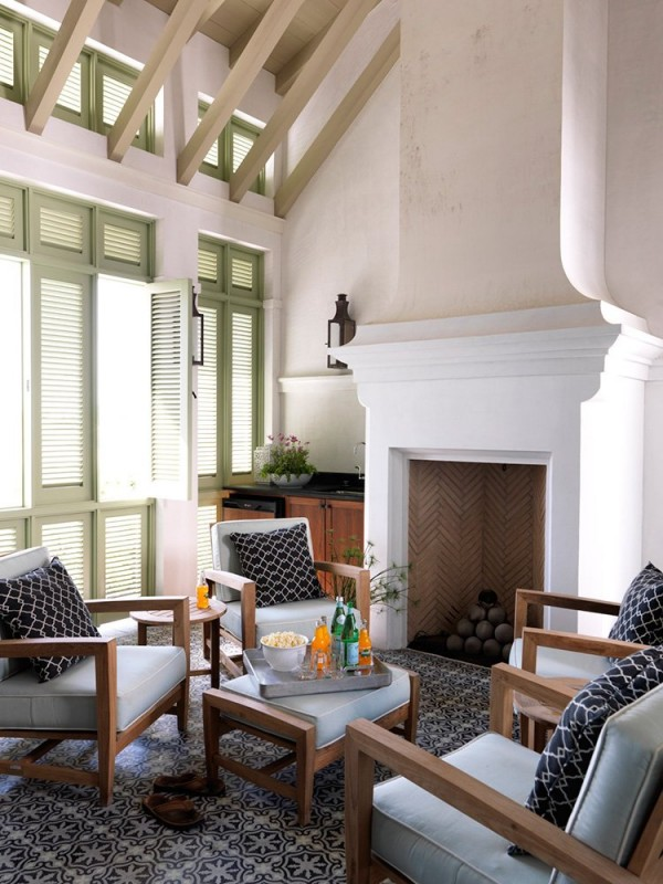 coastal style family room green shutters mohon-imber architects