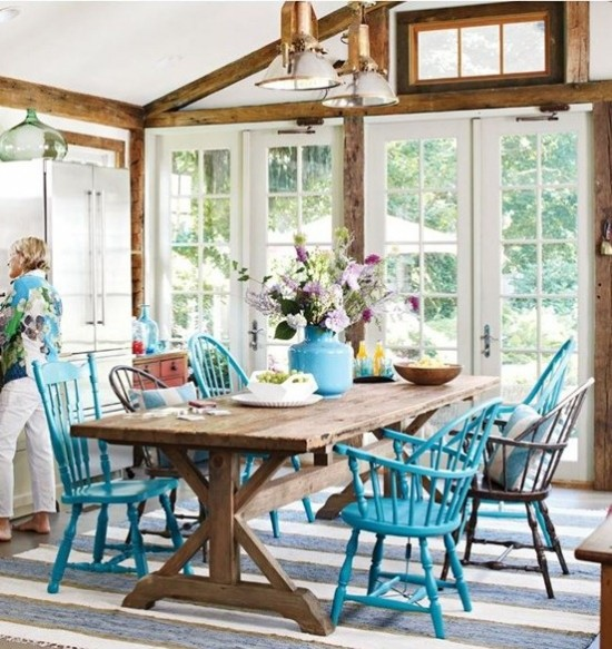 dining room with blue painted chairs