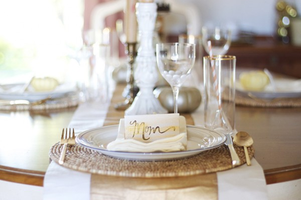 Beautiful gold tablescape with DIY placecards