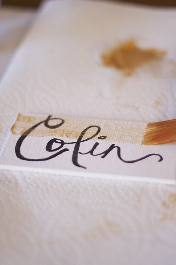 Gold painted DIY placecards for Thanksgiving dinner table