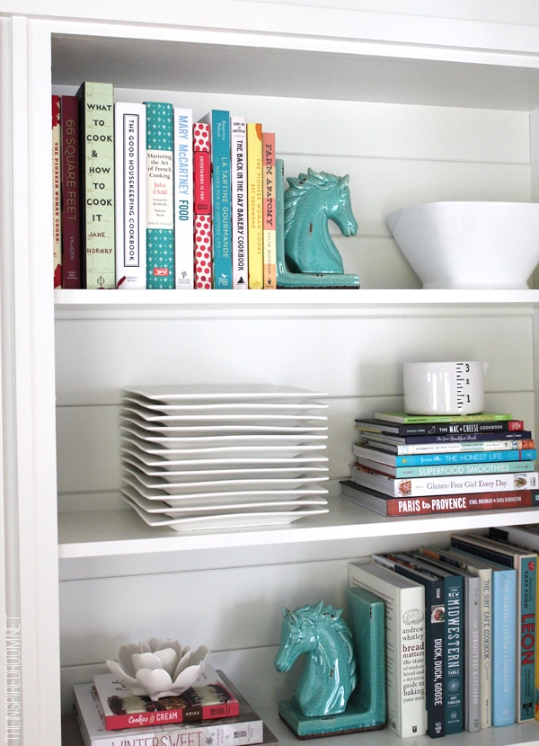 Styling cookbooks and dishes together on open shelves
