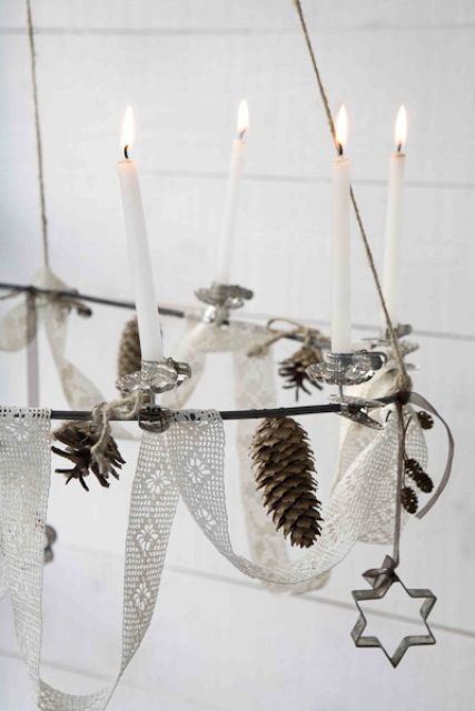 embellished chandelier with pinecones