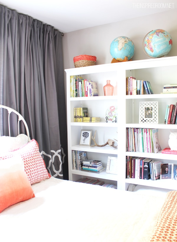 three bookcases in bedroom for library