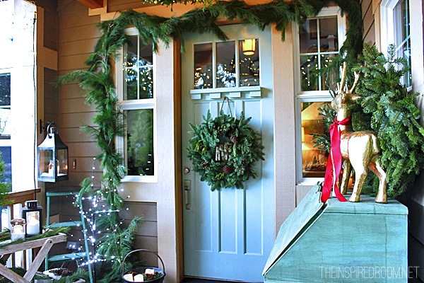 my christmas front porch diy boxwood wreath chandelier the inspired room. Black Bedroom Furniture Sets. Home Design Ideas