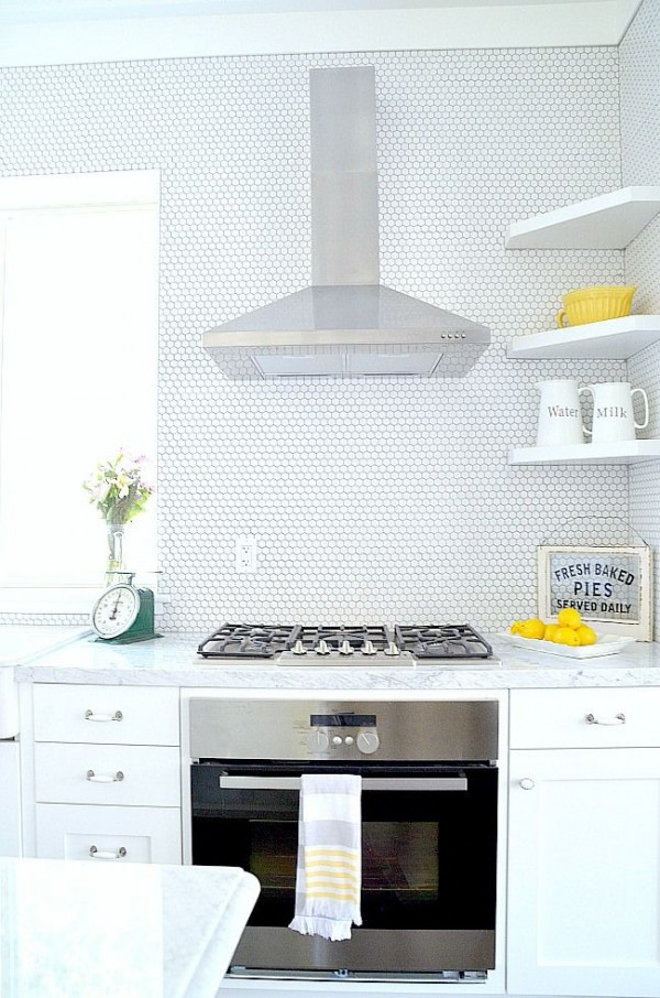 Hex Tile Behind Stovetop in White Kitchen