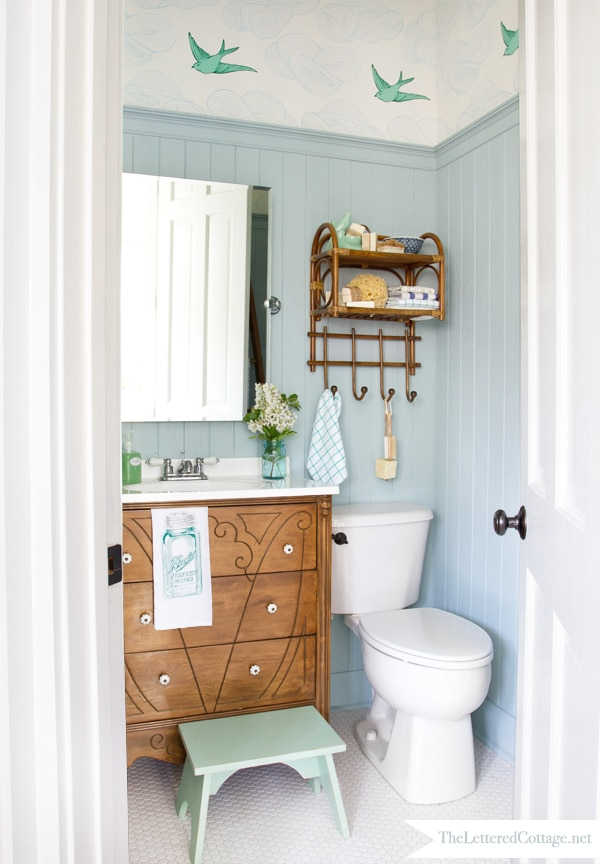 Half Bath with Bird Wallpaper and Wainscoting
