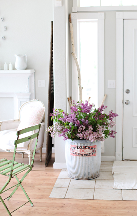 Pretty White Entryway with Industrial Bucket of Flowers