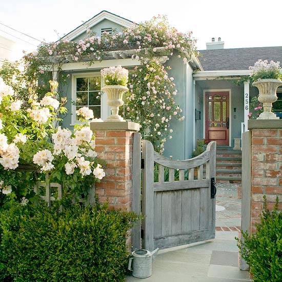 Blue Cottage with Great Curb Appeal - Entry Gate with Flowers