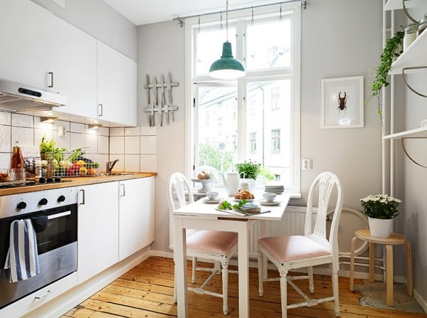 White Kitchen with Green Industrial Pendant Light