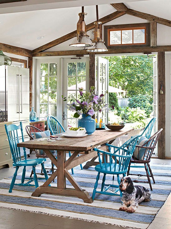 Casual Kitchen Dining Room with Wood Trestle Table and Mismatched Painted Chairs