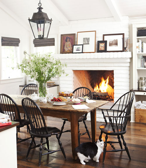 Cozy Dining Room with White Brick Fireplace - Lantern - Black Windsor Chairs