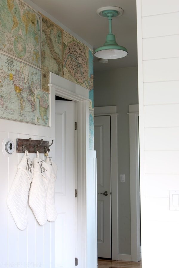 Map Wallpapered Hallway - White Stockings on Hooks - The Inspired Room Christmas House Tour