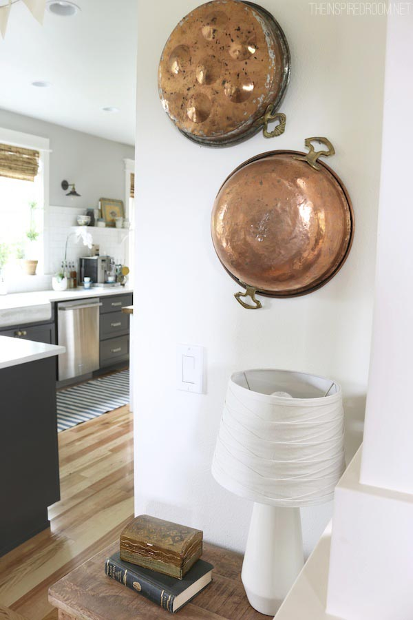 Copper Cookware Hung on the Wall - The Inspired Room