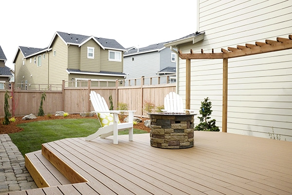 Backyard Trex deck with propane firepit