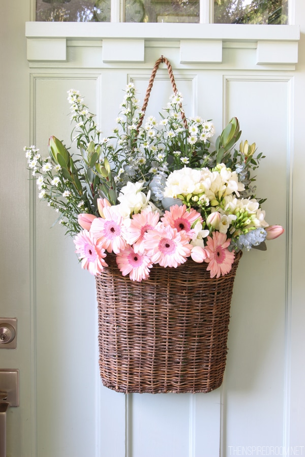 Fresh cut spring flowers in a door basket the inspired room Spring flower arrangements for front door