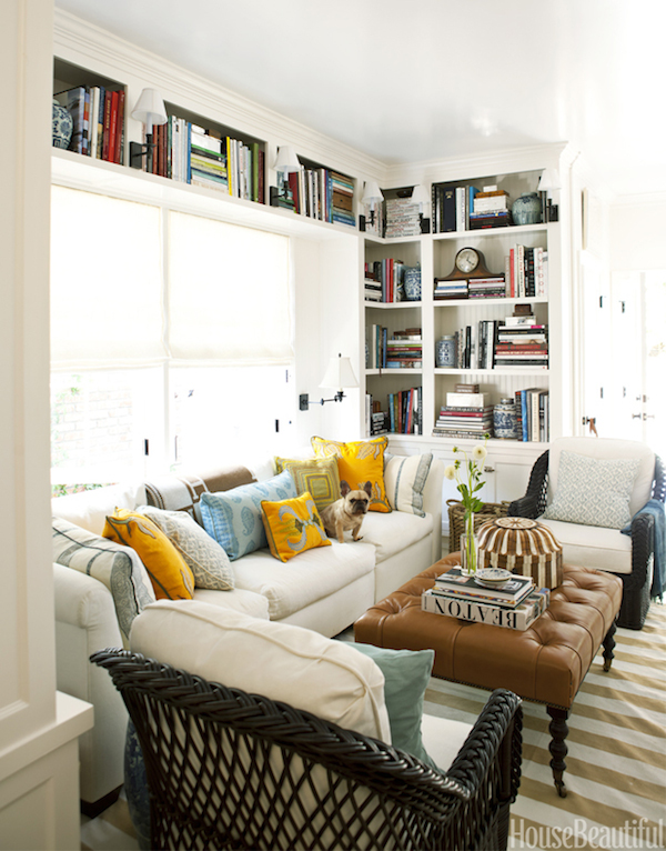 Cozy White Living Room with Built Ins Around Window - Mark D Sikes