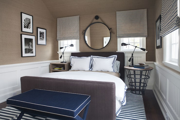 Bedroom with grasscloth wallpaper and navy accents SB Long Interiors