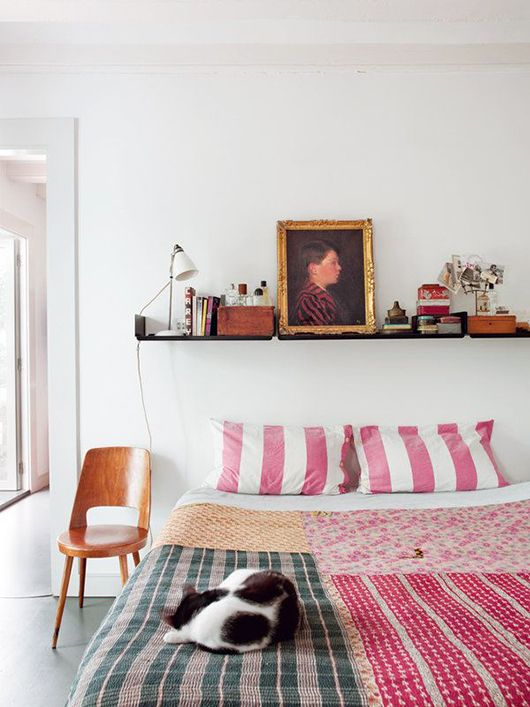 Bedroom with Pink Striped Pillows - Photo by Nuevo Estilo