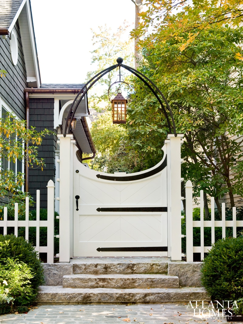 Charming White Garden Gate with Metal Arbor