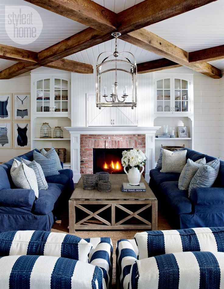 Coastal Living Room - Wood Beams At 45 Degree Angle Over White Beadboard