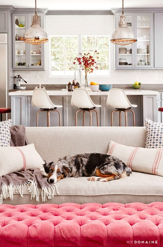 Gray and White Living Space with Pink Tufted Ottoman - Constance Zimmer