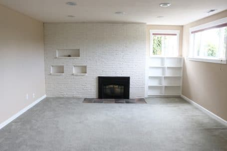 Basement Before - White Fireplace