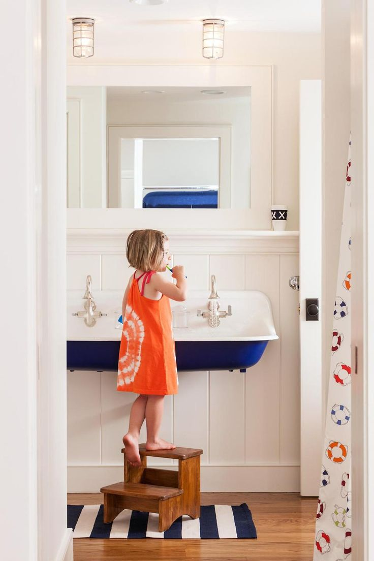 Blue and White Bathroom Trough Sink with Shiplap Walls