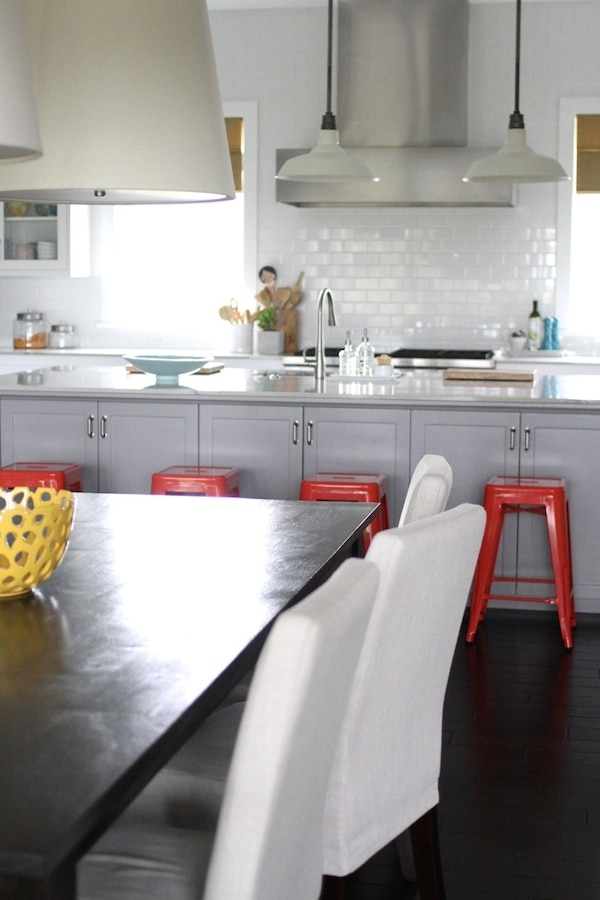 Brown Eyed Fox - Gray and White Kitchen with Red Metal Stoolsjpeg