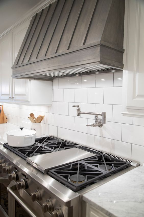 Fixer Upper Farmhouse Kitchen by Chip and Joanna Gaines - Gray Stained Wood Covered Range Hood