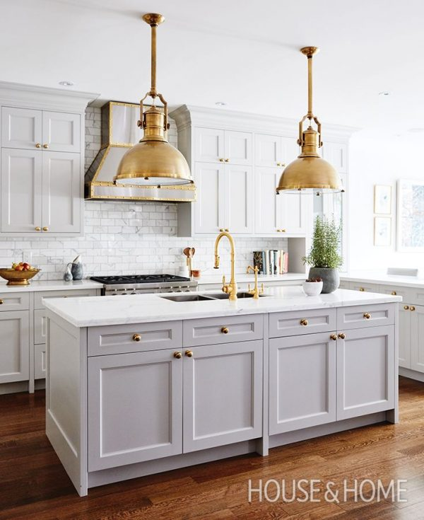 Gray Kitchen with Statement Gold Light Fixtures