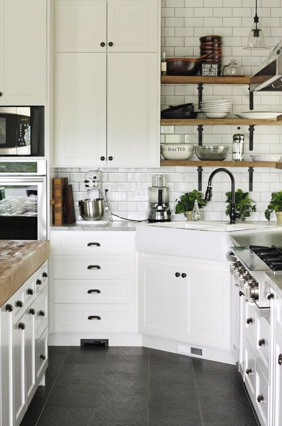 Inspiration for Kitchens with Black Hardware - Black White and Wood Kitchen with Slate Floors